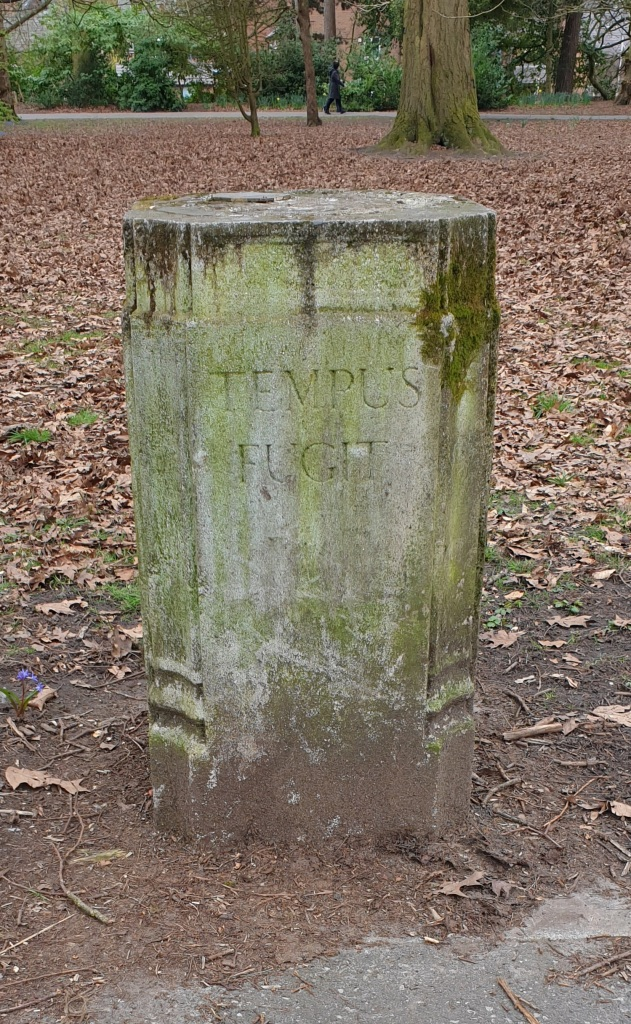Stone pillar engraved with the Latin words Tempus Fugit