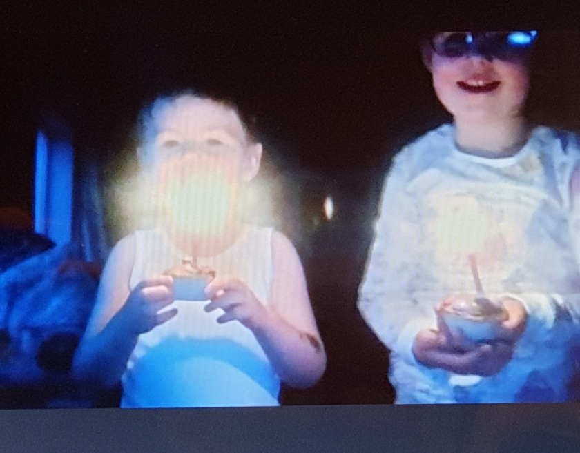 Two children, each holding a fairy cake with a lit candle